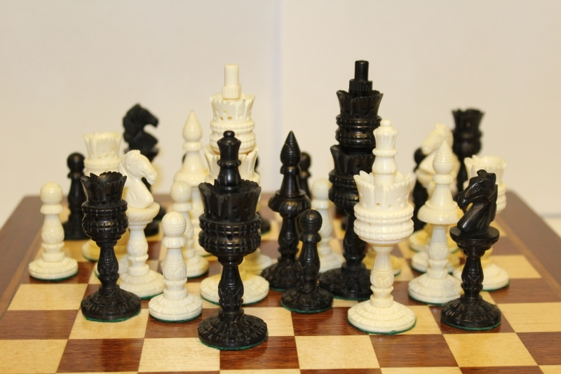 Bone chess with wooden board
